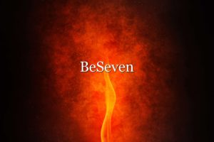 Fond d'écran avec une flamme en arrière-plan et le nom BeSeven au centre
